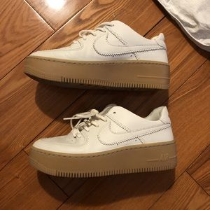 Nike Air Force 1s. Cream leather with gum sole.